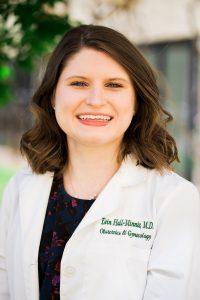Dr. Hall Minnie wearing lab coat